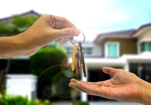 Purchasing property with two hands and key
